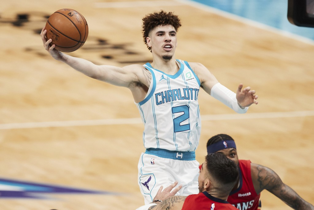 Charlotte Hornets guard LaMelo Ball (2) drives to the basket during the second half of an NBA basketball game against the New Orleans Pelicans, Sunday...
