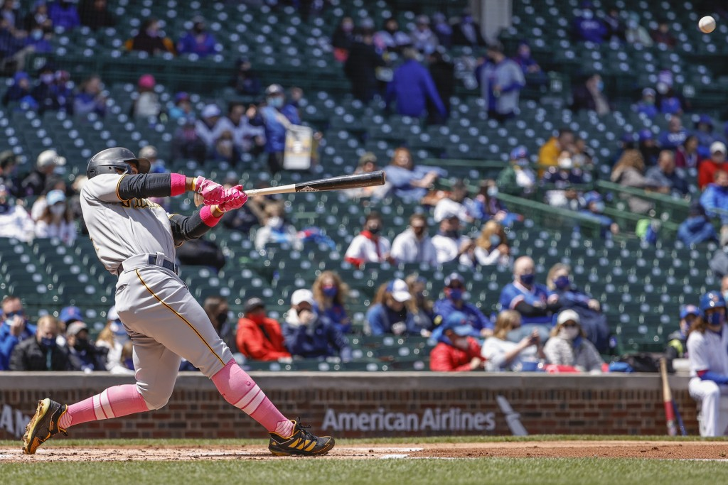 Pittsburgh Pirates' Wilmer Difo hits a two-run single off Chicago Cubs starting pitcher Kyle Hendricks during the first inning of a baseball game, Sun...