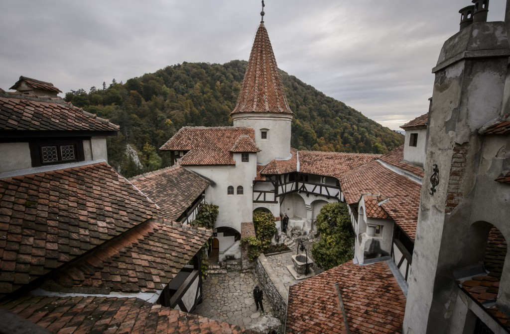 FILE - In this Oct. 9, 2016, file picture men stand in the inner courtyard of Bran Castle Romanian authorities have set up a COVID-19 vaccination cent...