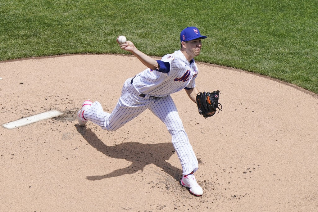 New York Mets starting pitcher Jacob deGrom delivers during the first inning of a baseball game against the Arizona Diamondbacks, Sunday, May 9, 2021,...