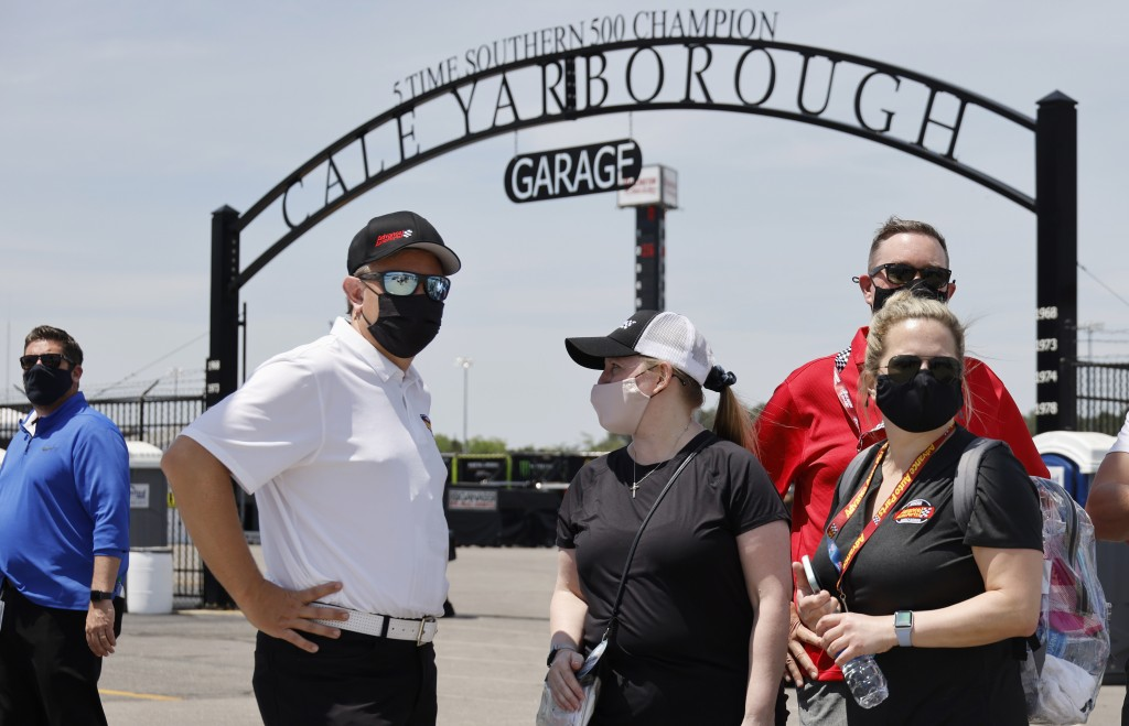 Fans check out activity in the garage area before a NASCAR Cup Series auto race at Darlington Raceway, Sunday, May 9, 2021, in Darlington, S.C. It is ...