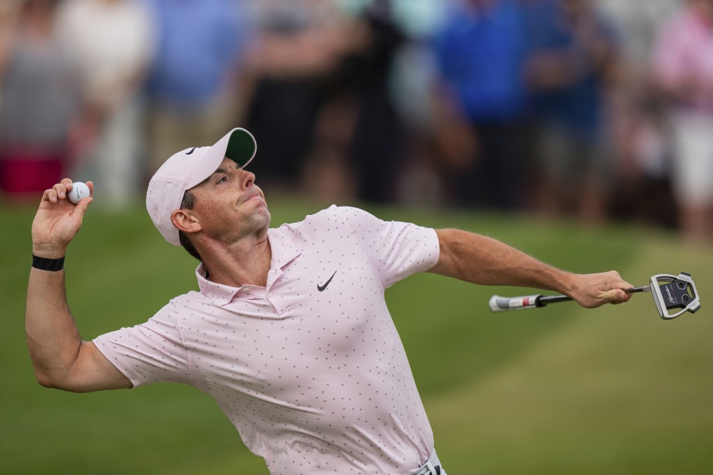 Rory McIlroy throws his ball to the crowd after winning on the 18th hole during the fourth round of the Wells Fargo Championship golf tournament at Qu...