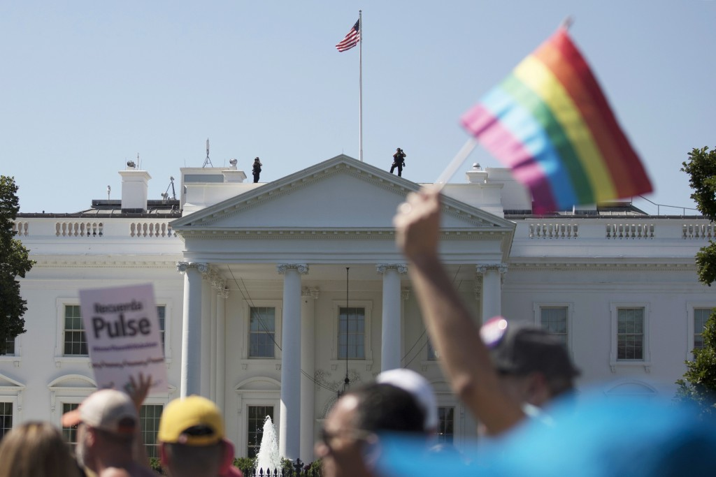 FILE - In this Sunday, June 11, 2017 file photo, Equality March for Unity and Pride participants march past the White House in Washington. The Biden a...