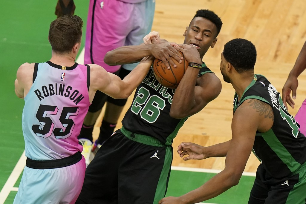 Boston Celtics' Aaron Nesmith (26) vies for control the ball with Miami Heat's Duncan Robinson (55) as Celtics' Tristan Thompson, right, looks on in t...