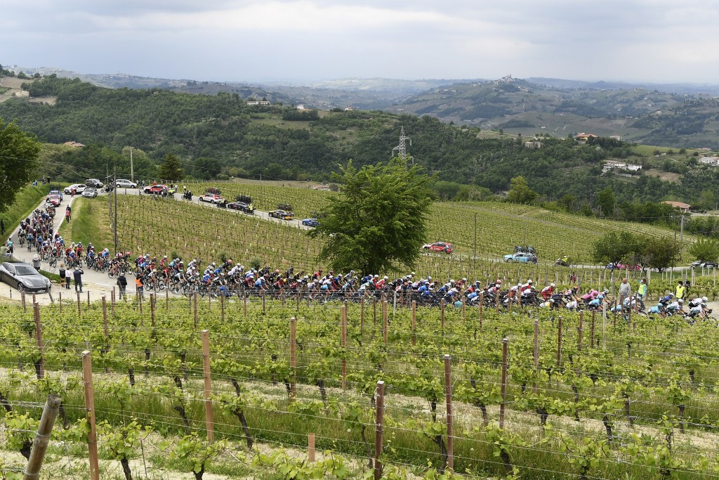 Cyclists pedal during the third stage of the Giro d'Italia, tour of Italy cycling race from Biella to Canale, Italy, Monday, May 10, 2021. (Fabio Ferr...