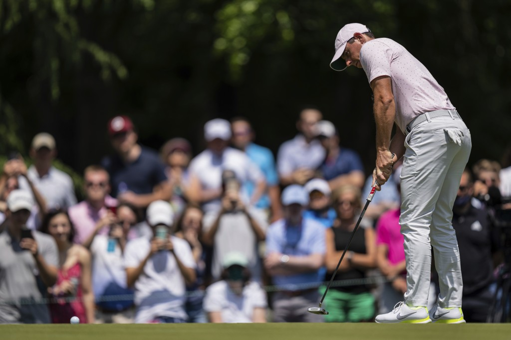 Rory McIlroy watches his putt on the third hole during the fourth round of the Wells Fargo Championship golf tournament at Quail Hollow on Sunday, May...