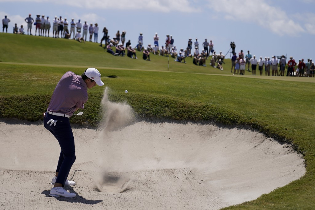 Davis Thompson, of the USA team, hits from the bunker on the 17th hole in the foursome matches during the Walker Cup golf tournament at the Seminole G...