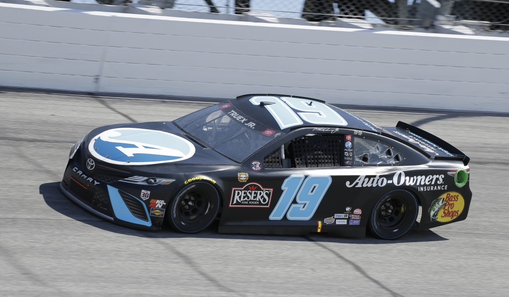 Martin Truex Jr. drives into Turn 1 during the NASCAR Cup Series auto race at Darlington Raceway, Sunday, May 9, 2021, in Darlington, S.C. (AP Photo/T...