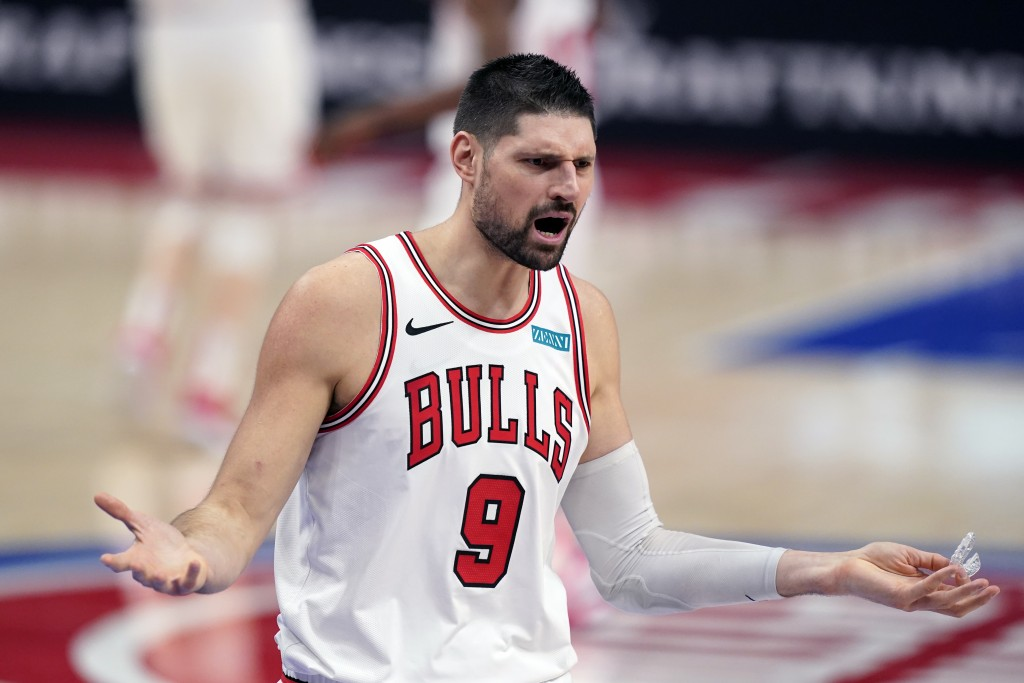 Chicago Bulls center Nikola Vucevic reacts after a foul during the second half of an NBA basketball game against the Detroit Pistons, Sunday, May 9, 2...