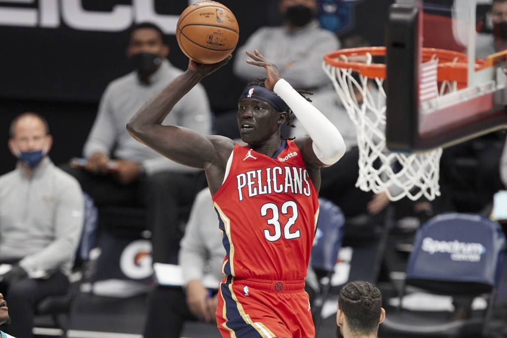 New Orleans Pelicans forward Wenyen Gabriel (32) looks to pass the ball during the first half of the team's NBA basketball game against the Charlotte ...
