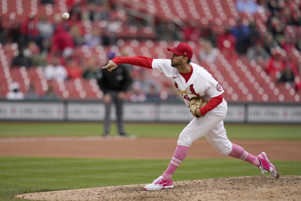 St. Louis Cardinals starting pitcher Adam Wainwright throws during the ninth inning of a baseball game against the Colorado Rockies Sunday, May 9, 202...