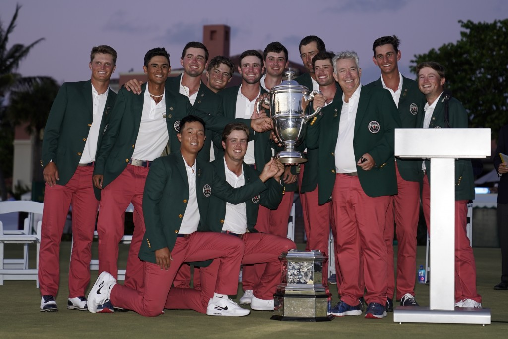 The USA team holds the trophy after winning the Walker Cup golf tournament against the Great Britain and Ireland team at the Seminole Golf Club on Sun...