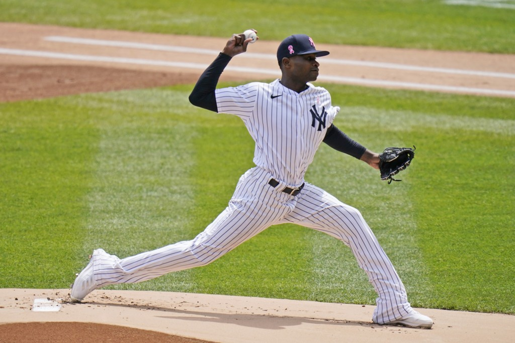 New York Yankees starting pitcher Domingo German throws during the first inning of a baseball game against the Washington Nationals at Yankee Stadium,...