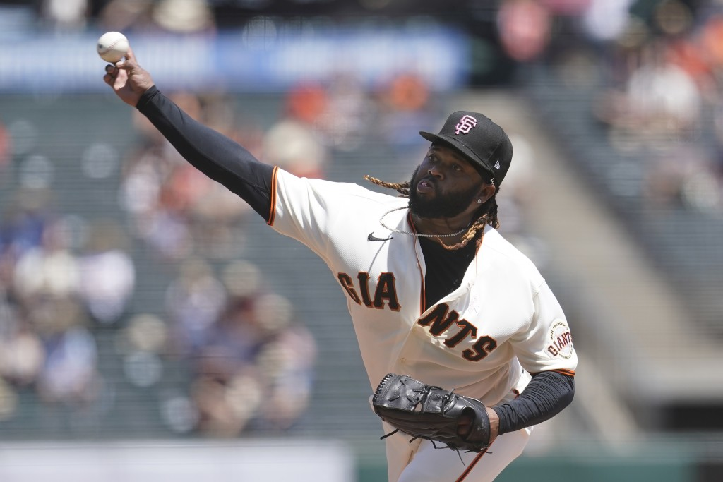 San Francisco Giants' Johnny Cueto pitches against the San Diego Padres during the first inning of a baseball game in San Francisco, Sunday, May 9, 20...