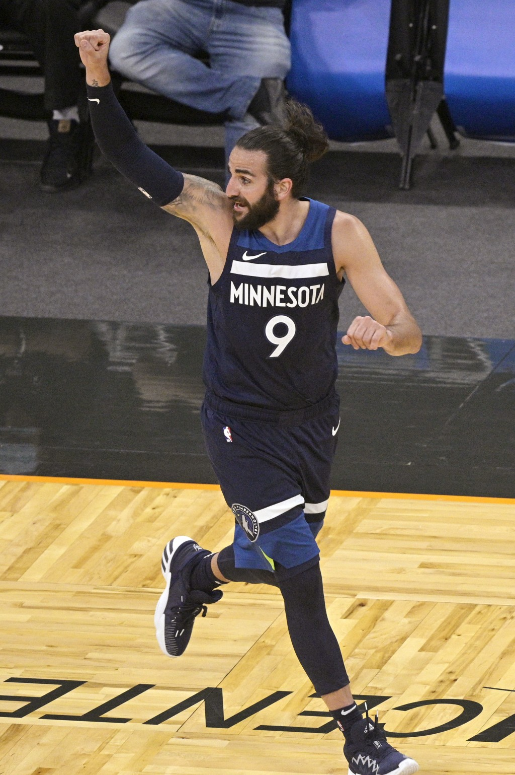 Minnesota Timberwolves guard Ricky Rubio reacts after scoring a 3-point basket during the second half of the team's NBA basketball game against the Or...