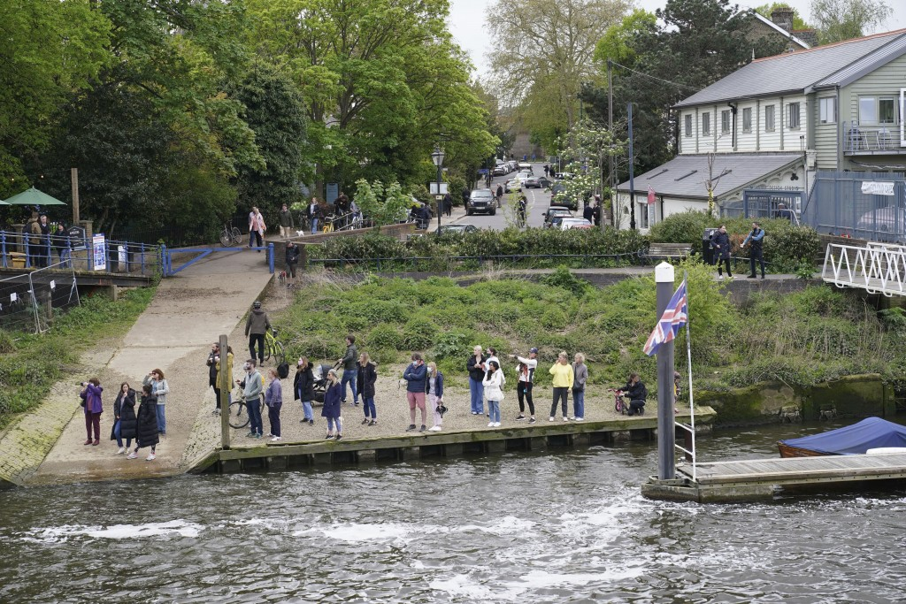 People gather at Teddington Lock to try and spot a Minke whale, which was freed on Sunday after it became stuck on Richmond lock's boat rollers but ha...