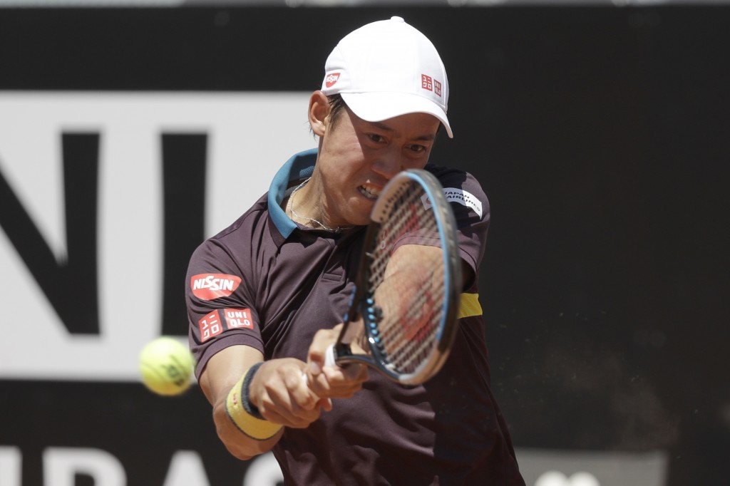 Japan's Kei Nishikori returns the ball to Italy's Fabio Fognini during their match at the Italian Open tennis tournament, in Rome, Monday, May 10, 202...