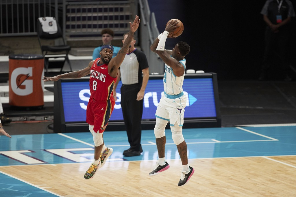 Charlotte Hornets guard Terry Rozier (3) shoots over New Orleans Pelicans forward Naji Marshall (8) during the first half of an NBA basketball game Su...