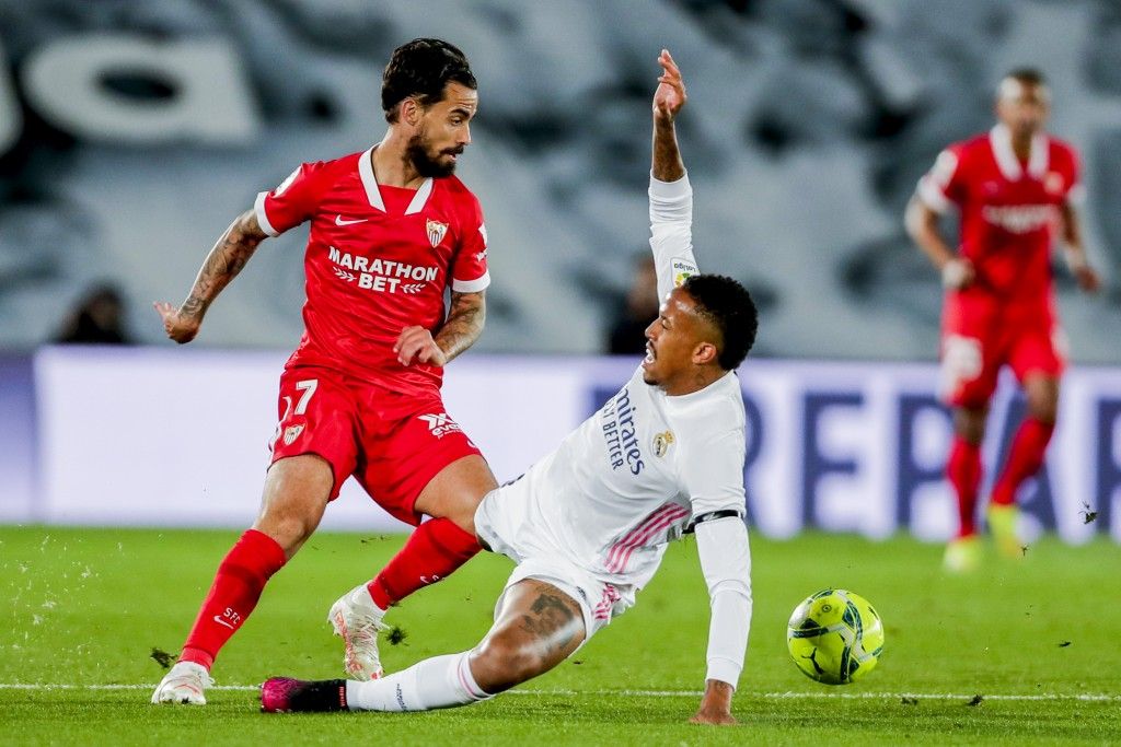 Sevilla's Suso, left, vies for the ball with Real Madrid's Eder Militao during the Spanish La Liga soccer match between Real Madrid and Sevilla at the...