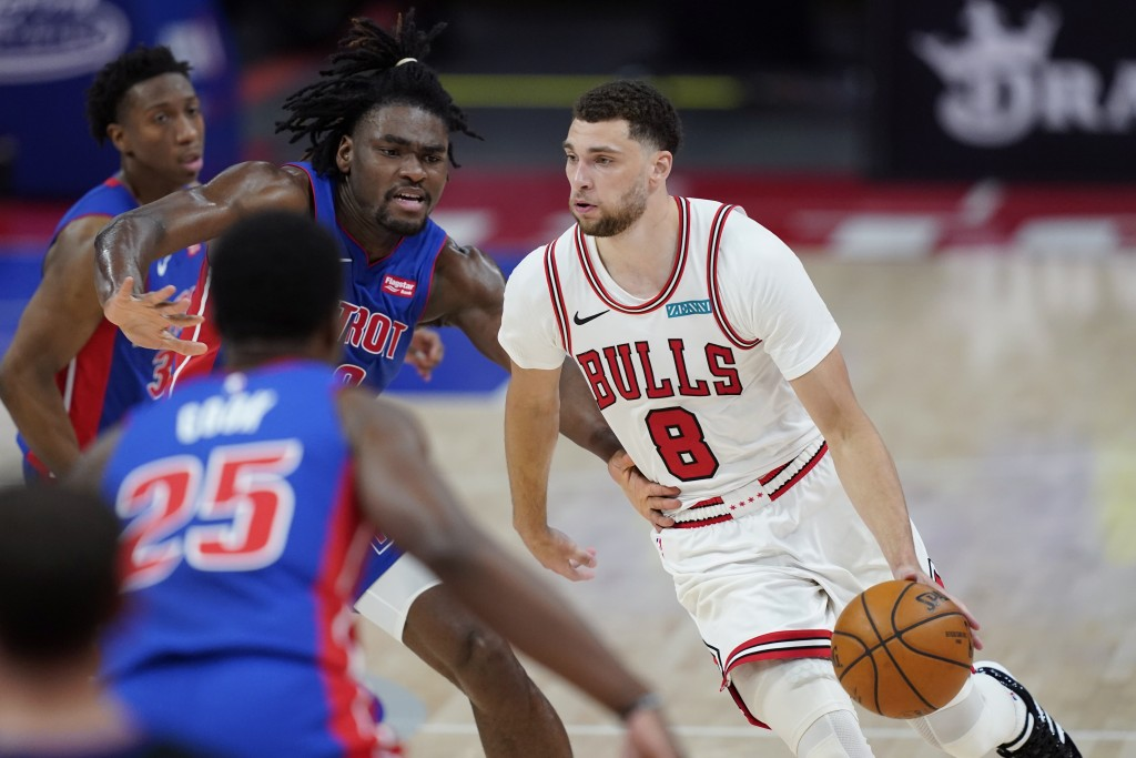 Chicago Bulls guard Zach LaVine (8) drives as Detroit Pistons center Isaiah Stewart defends during the second half of an NBA basketball game, Sunday, ...