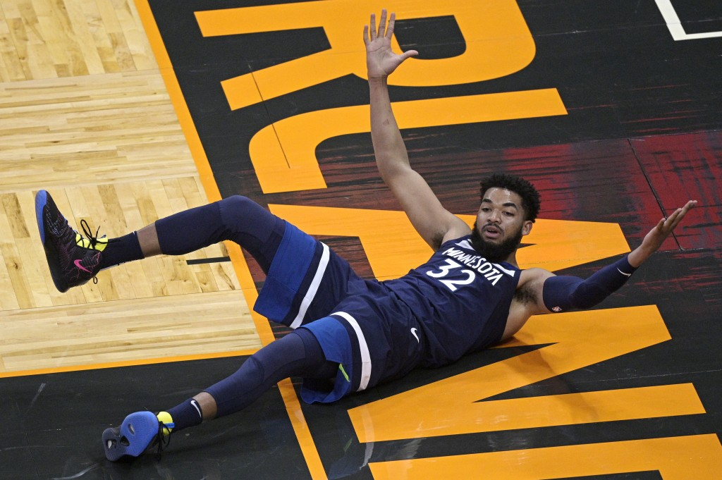 Minnesota Timberwolves center Karl-Anthony Towns reacts after a play where no foul was called during the first half of the team's NBA basketball game ...