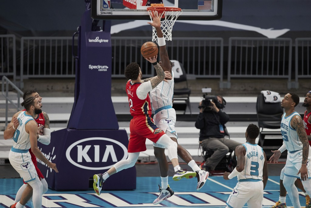 New Orleans Pelicans guard Lonzo Ball (2) tries to shoot over Charlotte Hornets center Bismark Biyombo during the second half of an NBA basketball gam...