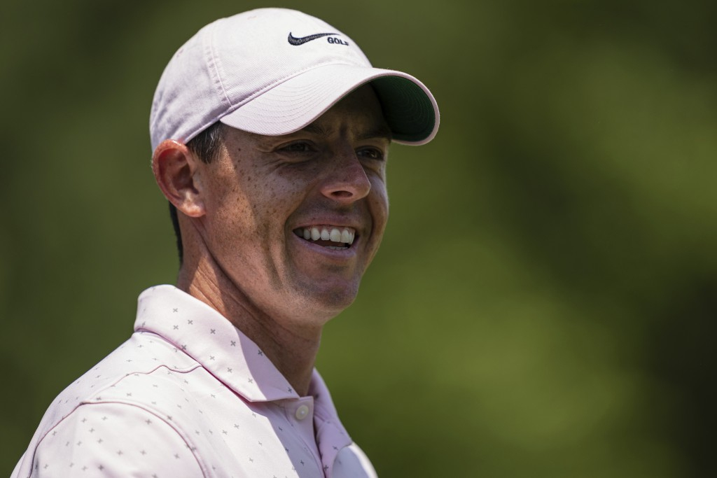 Rory McIlroy smiles after his putt on the third hole during the fourth round of the Wells Fargo Championship golf tournament at Quail Hollow on Sunday...