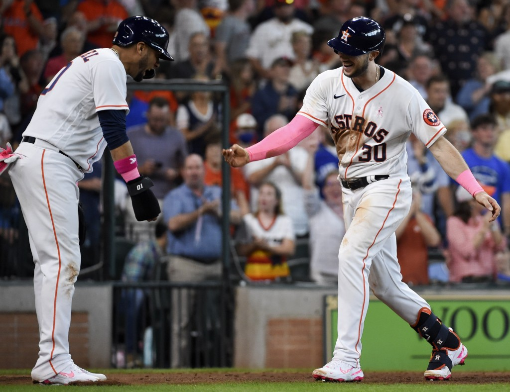 Houston Astros' Kyle Tucker (30) celebrates his three-run home run with Yuli Gurriel during the fourth inning of a baseball game against the Toronto B...