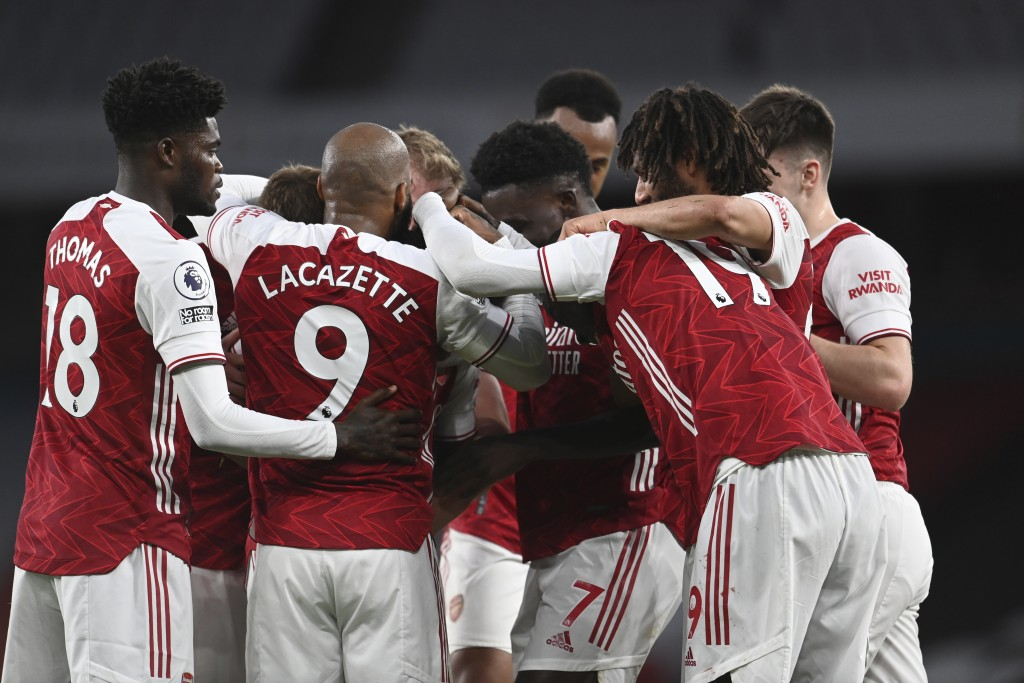 Arsenal players celebrate after Arsenal's Willian scored his side's third goal during the English Premier League soccer match between Arsenal and West...