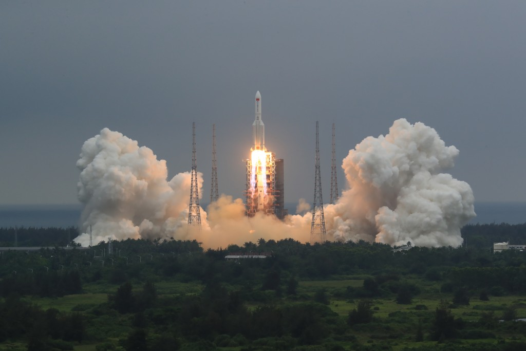FILE - In this April 29, 2021, file photo released by China's Xinhua News Agency, a Long March 5B rocket carrying a module for a Chinese space station...