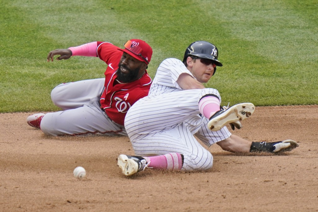 New York Yankees' DJ LeMahieu, right, steals second while Washington Nationals second baseman Josh Harrison cannot make the tag during the fifth innin...
