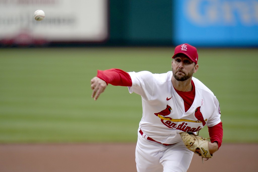 St. Louis Cardinals starting pitcher Adam Wainwright throws during the first inning of a baseball game against the Colorado Rockies Sunday, May 9, 202...