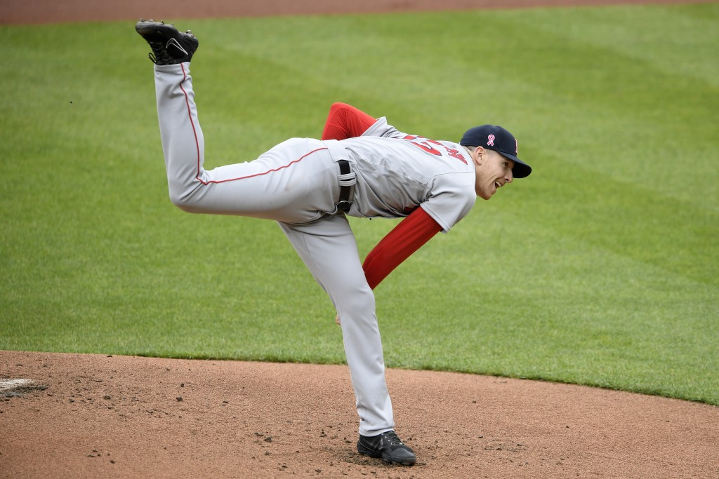 Boston Red Sox starting pitcher Nick Pivetta follows through on a pitch during the first inning of a baseball game against the Baltimore Orioles, Sund...