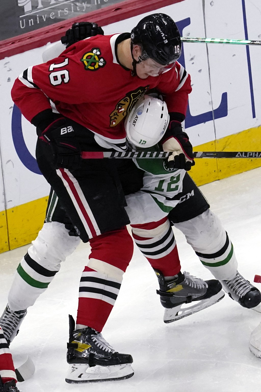 Chicago Blackhawks defenseman Nikita Zadorov, left, works for the puck against Dallas Stars center Radek Faksa during the second period of an NHL hock...