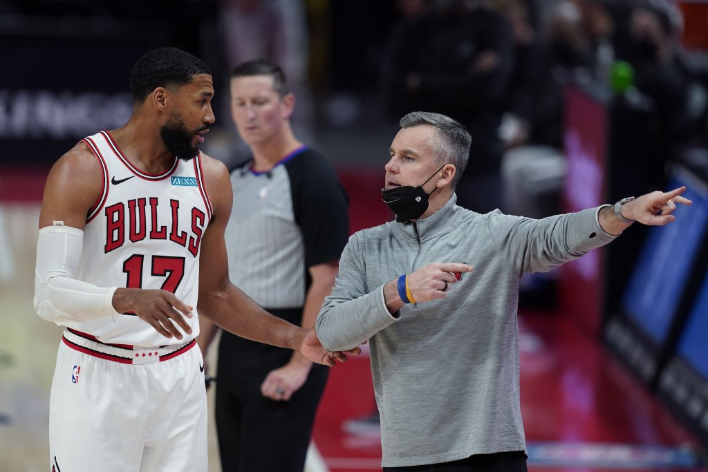 Chicago Bulls head coach Billy Donovan talks to forward Garrett Temple during the second half of an NBA basketball game against the Detroit Pistons, S...