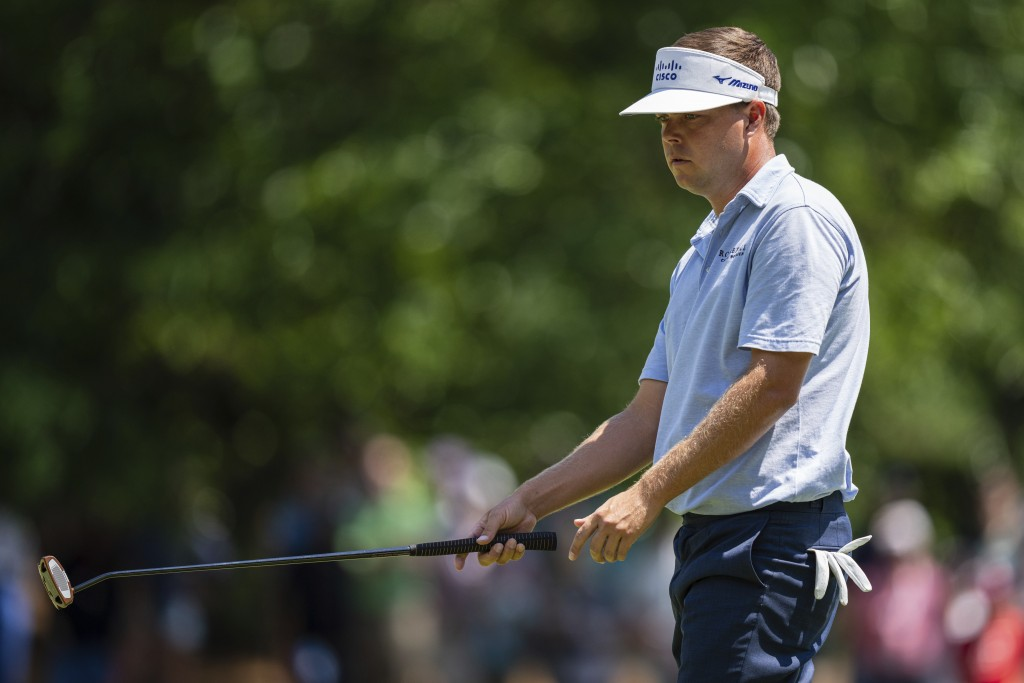 Keith Mitchell reacts after a missed putt on the sixth hole during the fourth round of the Wells Fargo Championship golf tournament at Quail Hollow on...