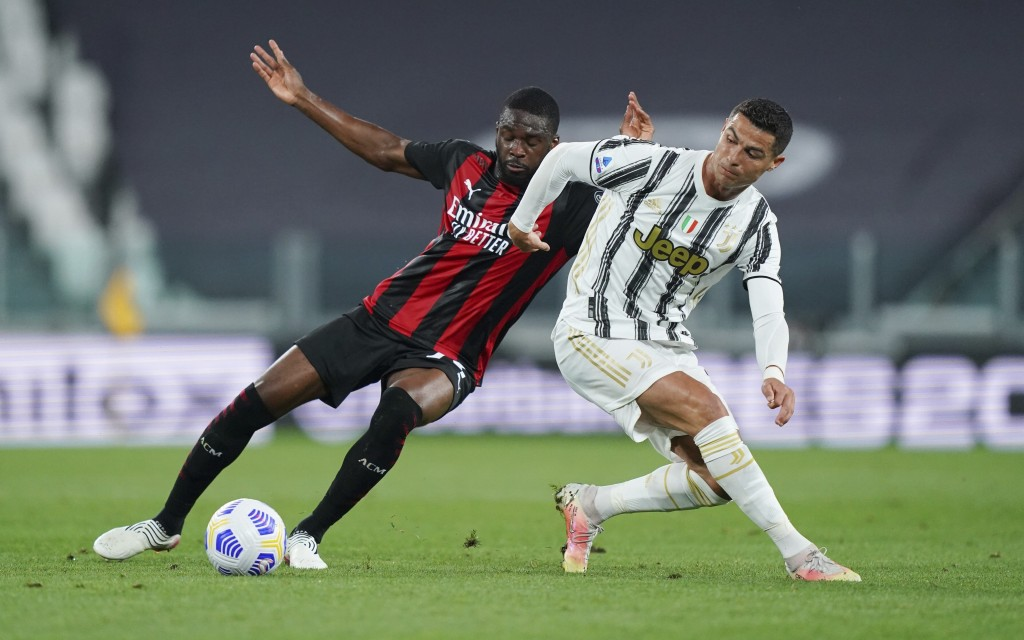 Inter Milan's Fikayo Tomori, left, competes for the ball against Juventus' Cristiano Ronaldo during the Italian Serie A soccer match between Juventus ...