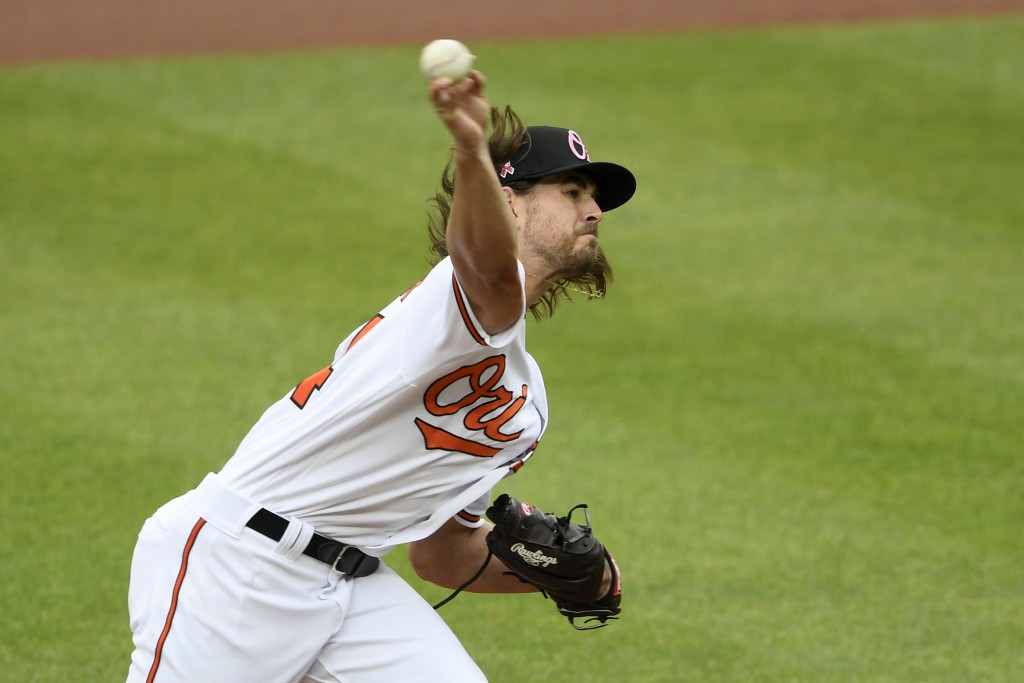 Baltimore Orioles starting pitcher Dean Kremer delivers a pitch during the first inning of a baseball game against the Boston Red Sox, Sunday, May 9, ...
