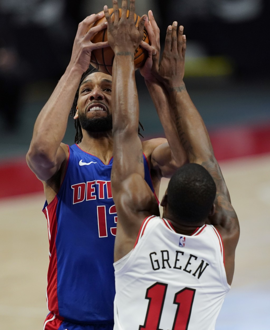Detroit Pistons center Jahlil Okafor (13) is defended by Chicago Bulls guard Javonte Green (11) during the first half of an NBA basketball game, Sunda...