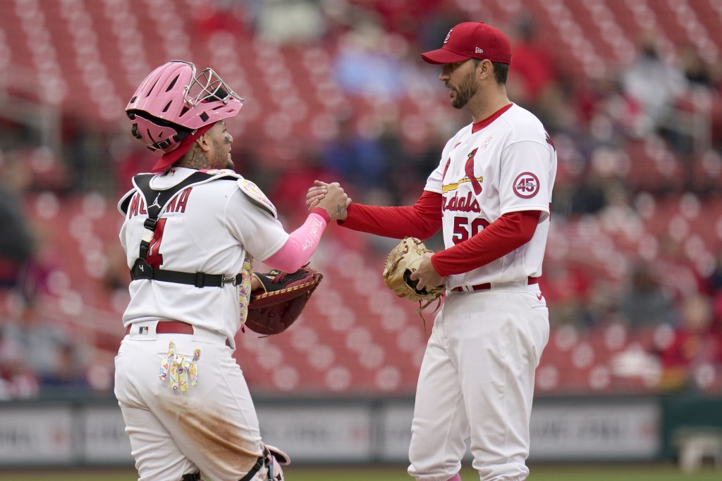 St. Louis Cardinals starting pitcher Adam Wainwright, right, is congratulated by teammate Yadier Molina before being removed during the ninth inning o...