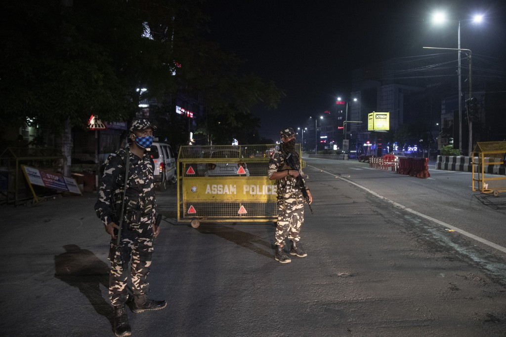 Indian paramilitary personnel guard during a night curfew to curb the spread of coronavirus in Gauhati, Assam, India, Sunday, May 9, 2021. (AP Photo/A...