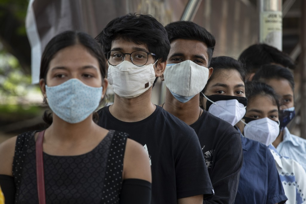 Indian youth above eighteen years age queue up to get vaccinated against the coronavirus in Gauhati, Assam, India, Monday, May 10, 2021. (AP Photo/Anu...