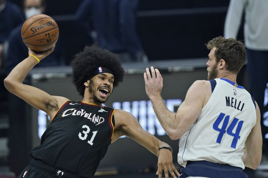 Cleveland Cavaliers' Jarrett Allen (31) tries to pass the ball against Dallas Mavericks' Nicolo Melli (44) in the first half of an NBA basketball game...