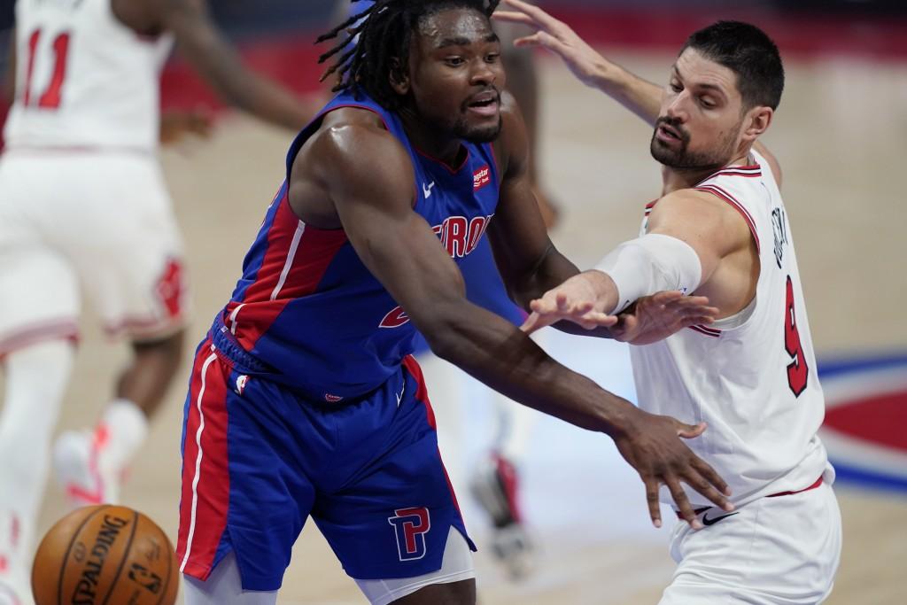 Chicago Bulls center Nikola Vucevic (9) knocks the ball away from Detroit Pistons center Isaiah Stewart during the second half of an NBA basketball ga...