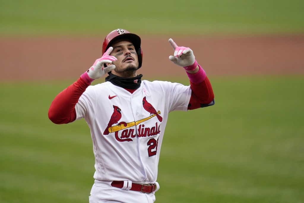 St. Louis Cardinals' Nolan Arenado celebrates after hitting a solo home run during the second inning of a baseball game against the Colorado Rockies S...