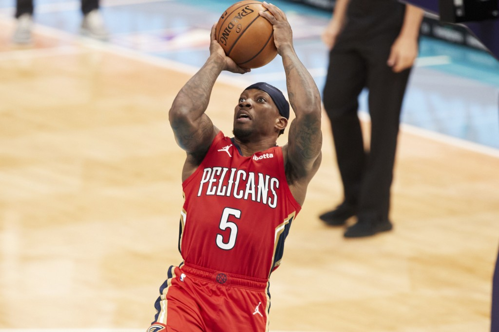 New Orleans Pelicans guard Eric Bledsoe (5) attempts a jump shot during the first half of an NBA basketball game against the Charlotte Hornets, Sunday...