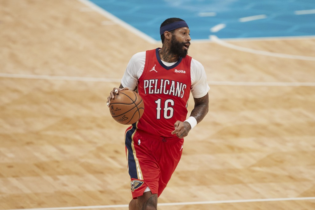 New Orleans Pelicans forward James Johnson (16) brings the ball up during the first half against the Charlotte Hornets in an NBA basketball game Sunda...