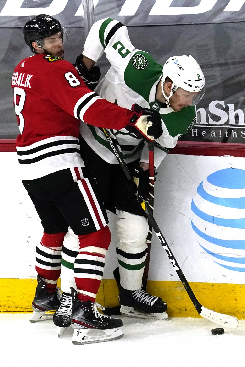 Dallas Stars defenseman Jamie Oleksiak, right, works for the puck against Chicago Blackhawks left wing Dominik Kubalik during the first period of an N...