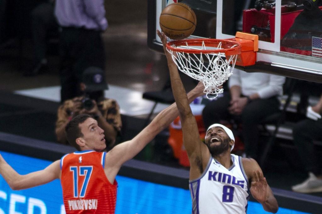 Sacramento Kings forward Maurice Harkless (8) makes a basket as Oklahoma City Thunder forward Aleksej Pokusevski (17) defends during the first quarter...