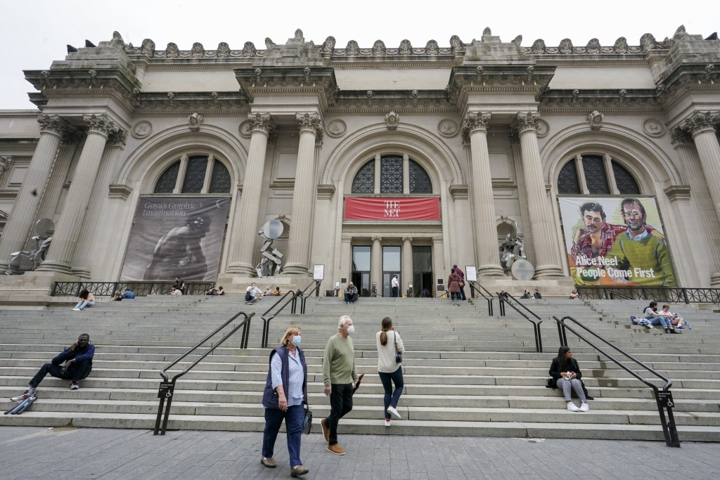 Visitors to the Museum of Modern Art are seen on the museum's staircase, Thursday, April 29, 2021, in New York. In recent weeks, tourism indicators fo...